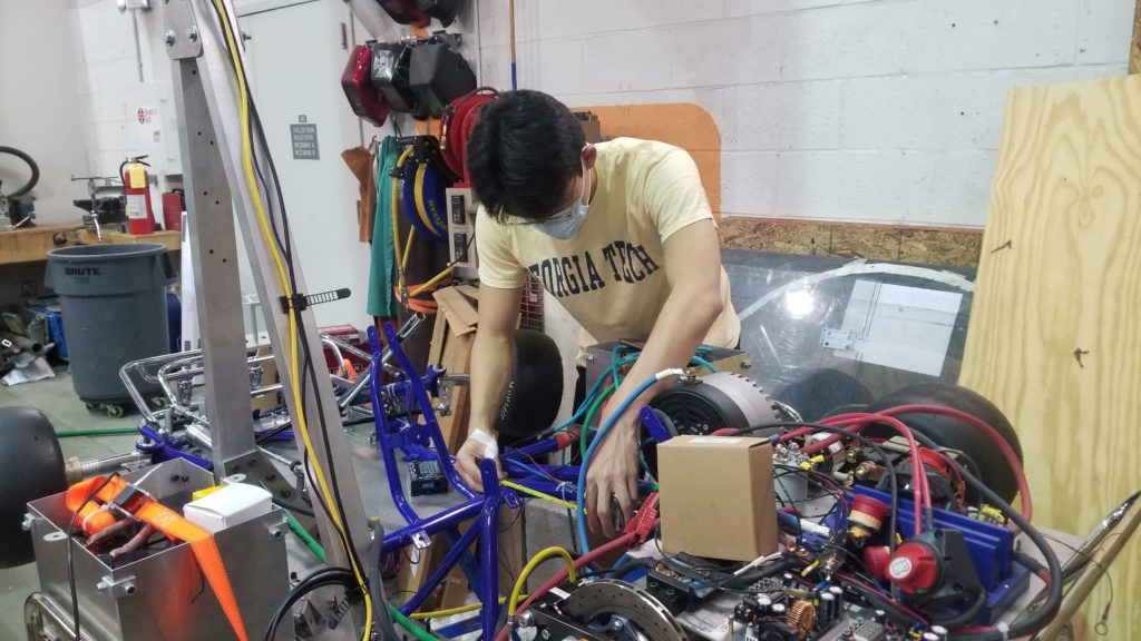 A RoboRacing member works on Rigatoni