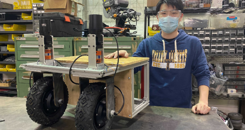 A member poses with the completed Swervi test rig